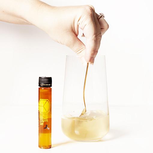honey-vial-stirring-glass